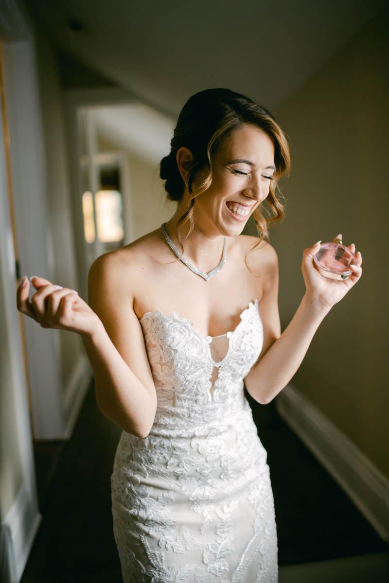 bride spraying perfume