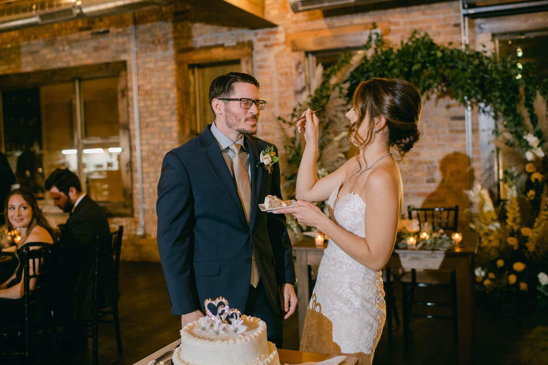 bride + groom cutting cake